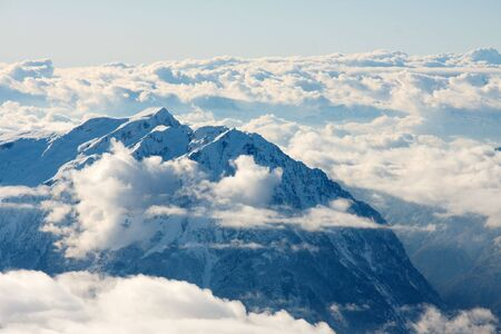 High mountain range with clouds covered by snow Stock Photo - 5606315