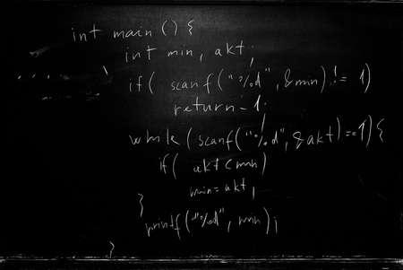 School blackboard with programming source code written on it