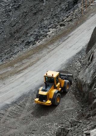 Construction machine in a dark rocky area Stock Photo - 5703329