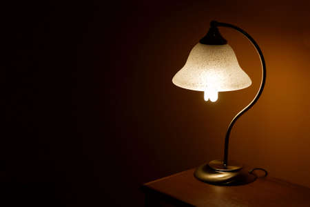 Lamp on a small table in the evening photo