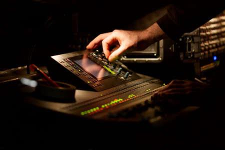 soundboard: Soundboard mixer in the dark at a concert Stock Photo