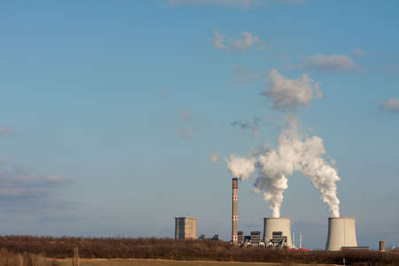 Smoke rising from a power plant Stock Photo - 5703385