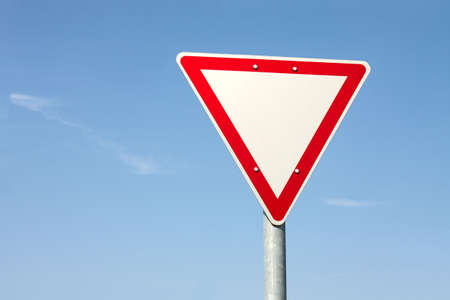 give way: Give way traffic sign against clear blue sky