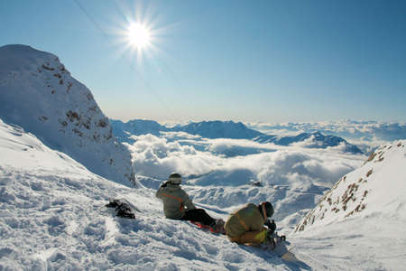 Ski resort in the high mountains in sunny weather photo