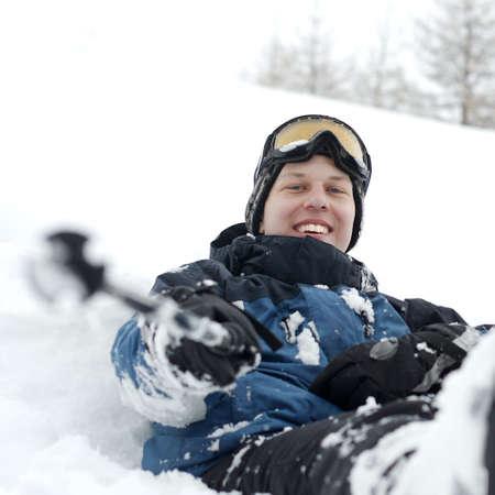 Happy skier sitting in the deep fresh snow Stock Photo - 5676023