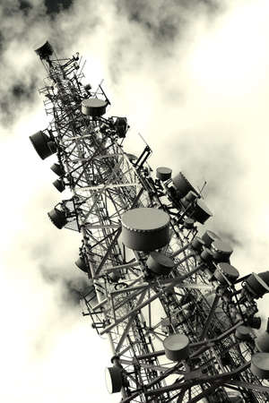 mast: Transmitter tower against dramatic sky Stock Photo
