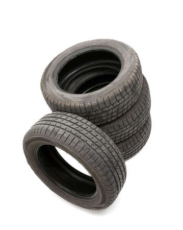 Four tyres isolated on white background photo