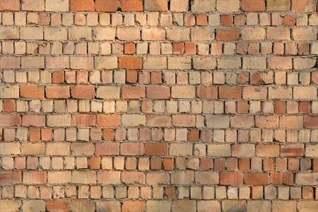 Brick wall texture with many bare bricks photo