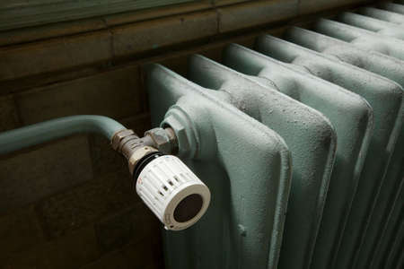 Closeup of a heating radiator in an old building photo