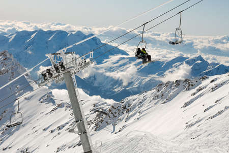 Ski resort in the high mountains with ski lift photo