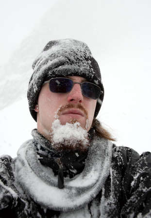 icy conditions: Portrait of a man with frozen beard in winter