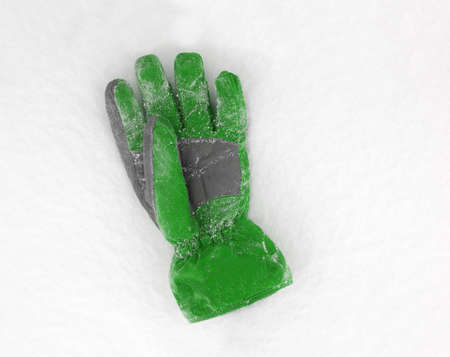seasonic: Green gloves in the fresh snow Stock Photo