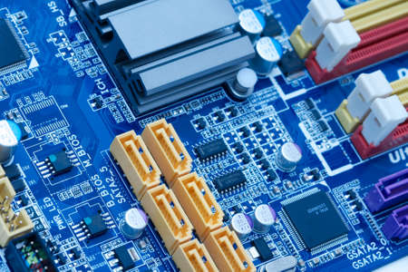 Computer motherboard with lots of electrical components photo