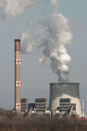 Smoke coming out of a power plant photo