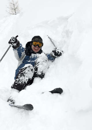 Skier falling over in deep fresh snow Stock Photo - 5832461