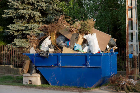 scrap heap: A big pile of garbage in a container Stock Photo