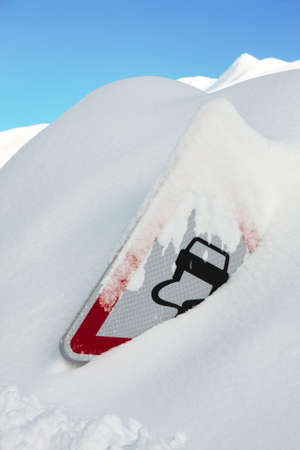 winter road: Traffic sign coverd by a lot of snow