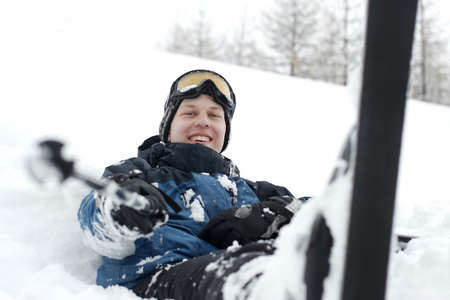 Skier resting in the snow Stock Photo - 5945612