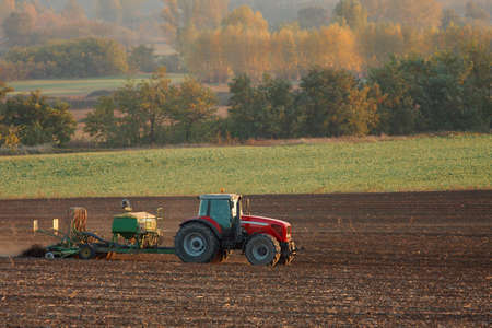Tractor plowing an agricultural field photo