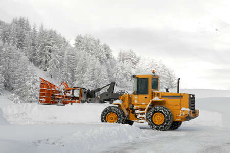 Removing snow from the road in winter photo