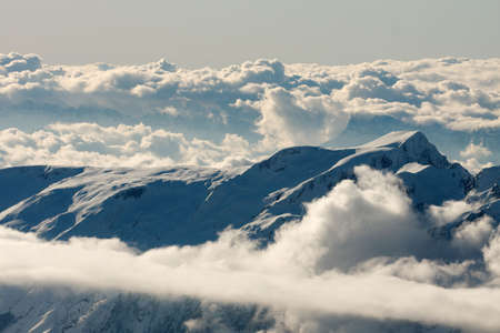 High mountain range among the clouds Stock Photo - 5999126
