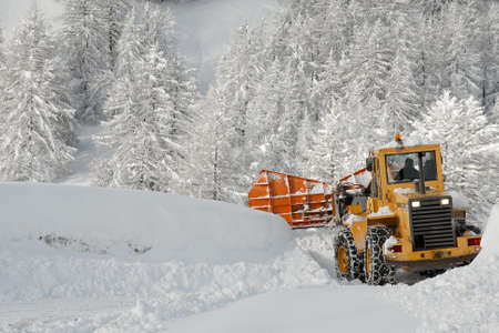 Removing snow from a road in winter photo