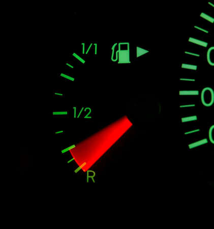 Fuel indicator of a car with motion blur photo