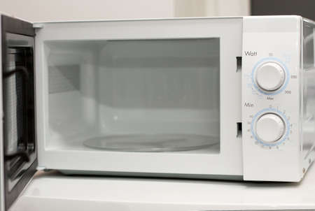 Microwave oven with open door photo