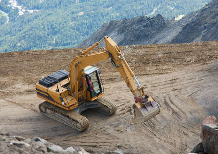 Construction machinery in a mountain landscape photo