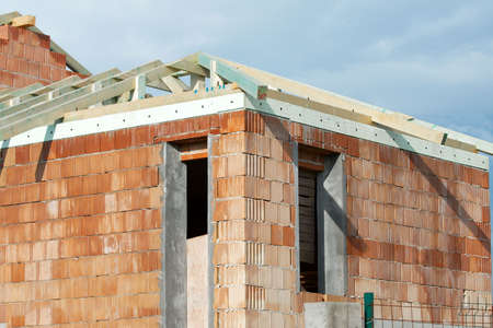 House under construction with brick walls photo