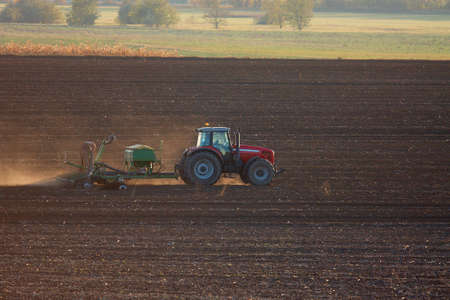 Tractor plowing the agricultural field photo