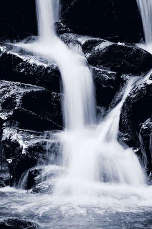 small stones: Waterfall rushing down the rocks