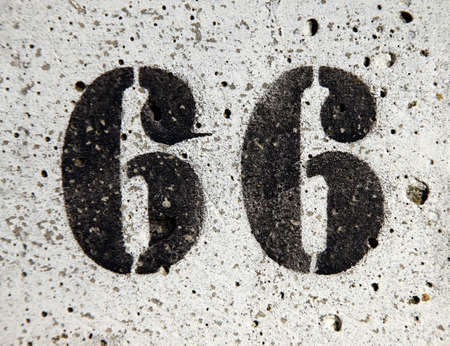 Numer 66 painted on a concrete surface Stock Photo - 6575704