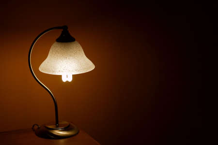 Small lamp glowing in the evening photo