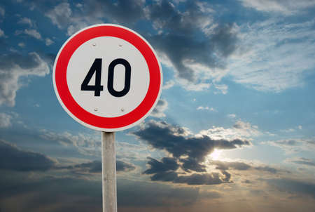 Speed limit traffic sign against cloudy sky photo