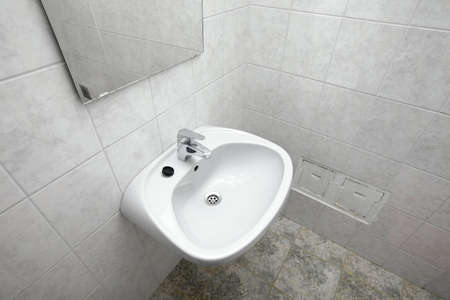 Tap and basin in a bathroom photo