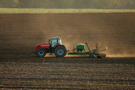 industrialized: Tractor plowing the fields