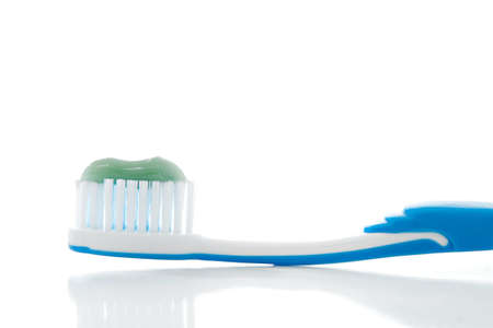 Toothbrush with paste isolated on white background