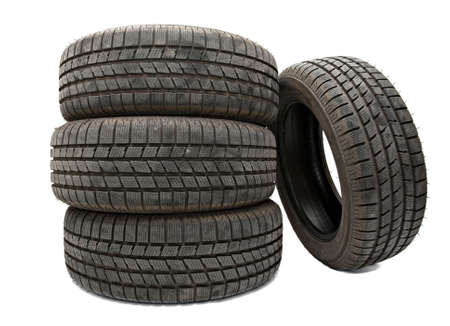 Car tyres in a pile isolated on white photo