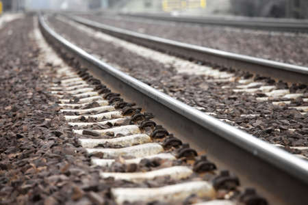 Railway tracks closeup detail, shallow DoF photo