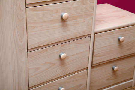 Detail of a wooden cabinet with drawers Stock Photo