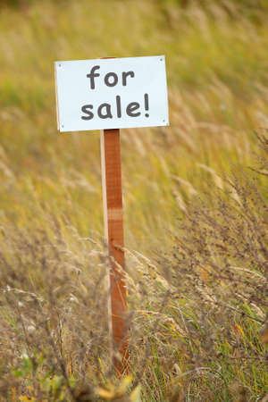 For sale signboard on a piece of ground photo