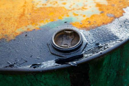 oil spill: Old rusty oil barrel detail