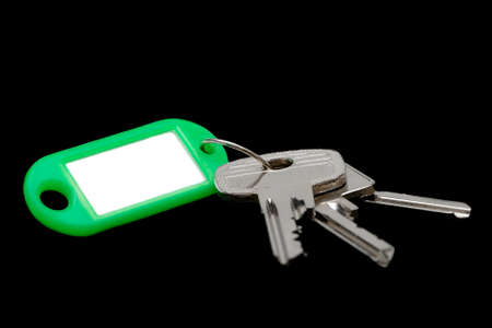 keyholder: Keys with blank label isolated on black background