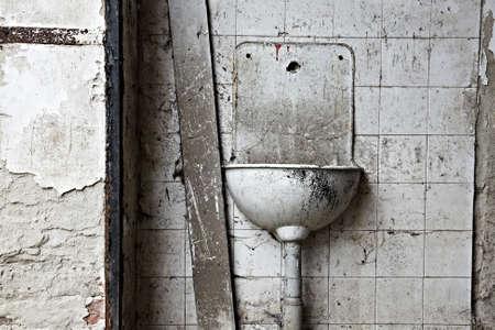 Abandon, ruined basin on dirty, grungy wall Stock Photo - 7163234