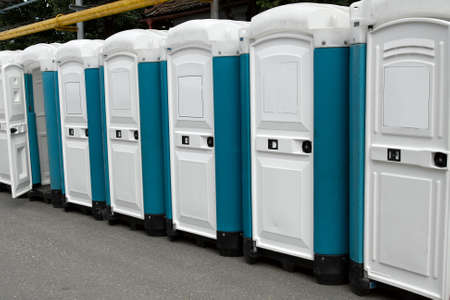 Row of portable toilets at an outdoor event