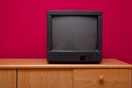 news room: Small black TV on a cabinet Stock Photo