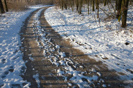 dirtroad: Dirtroad with snow in winter Stock Photo