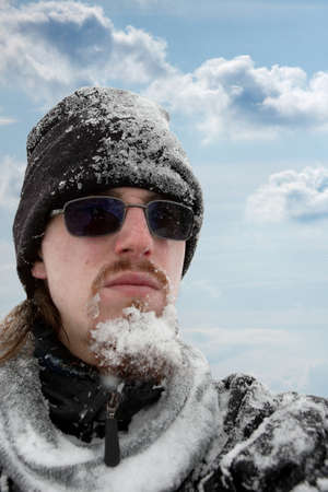 icy conditions: Frozen beard and clothes in the snow Stock Photo