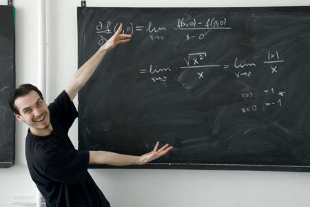 Young man showing math results on the blackboard happily Stock Photo - 7838493